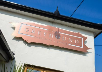 Greyhound Freehouse & Dining Sign on Wall