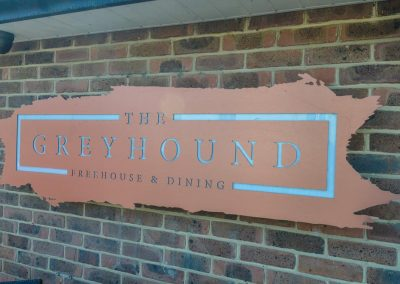 Greyhound Sign on Wall