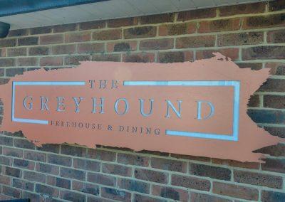 Greyhound Sign on Wall